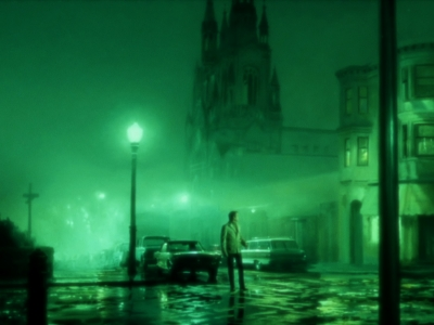 Still from THE GREEN FOG (2017) - a lone man stands in a foggy city street at night